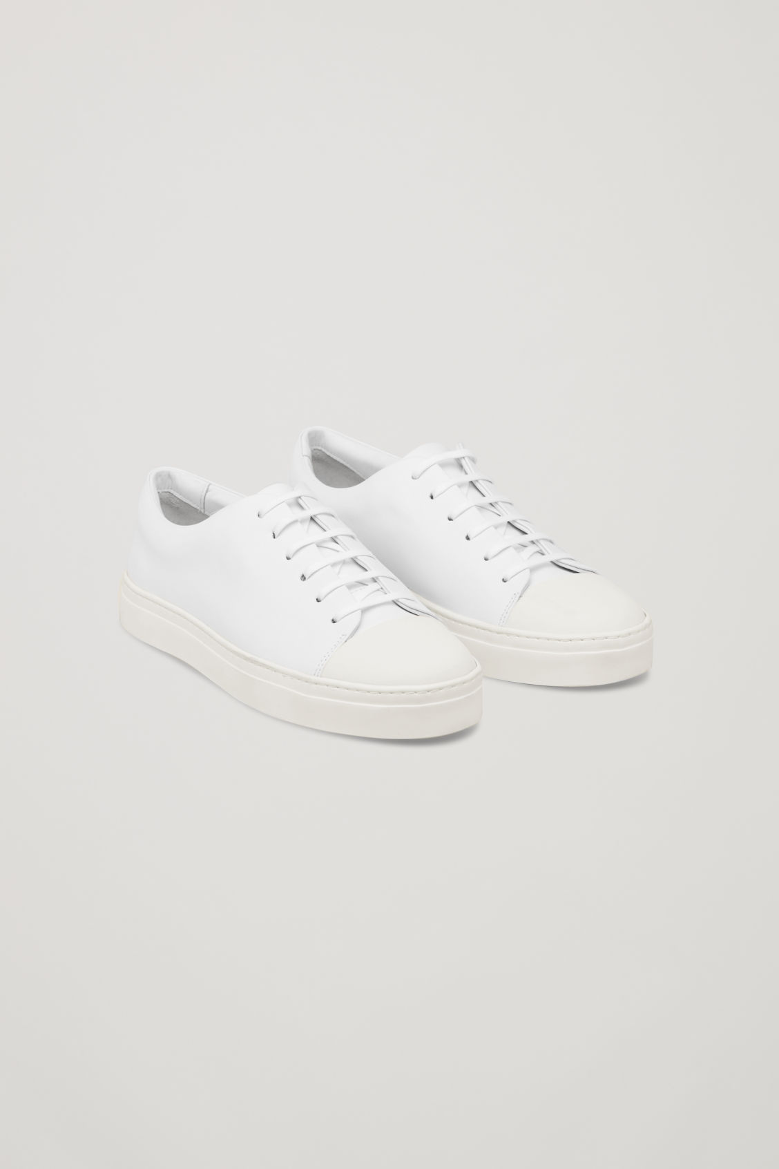 RUBBER-DETAILED LEATHER SNEAKERS