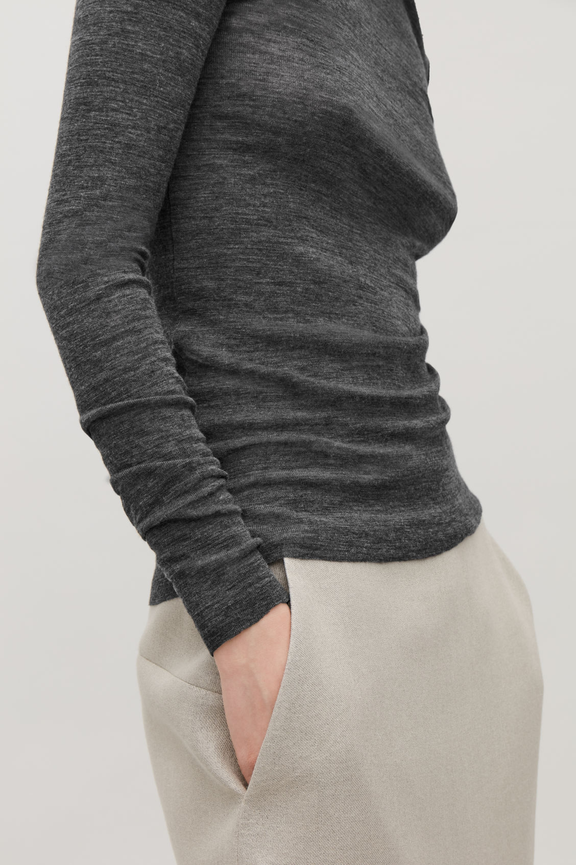 Model side image of Cos fine roll-neck wool top in grey