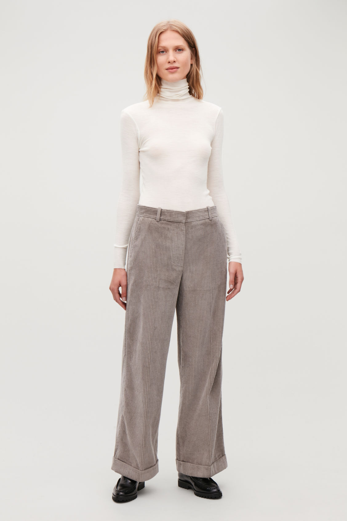 Model side image of Cos fine roll-neck wool top in white