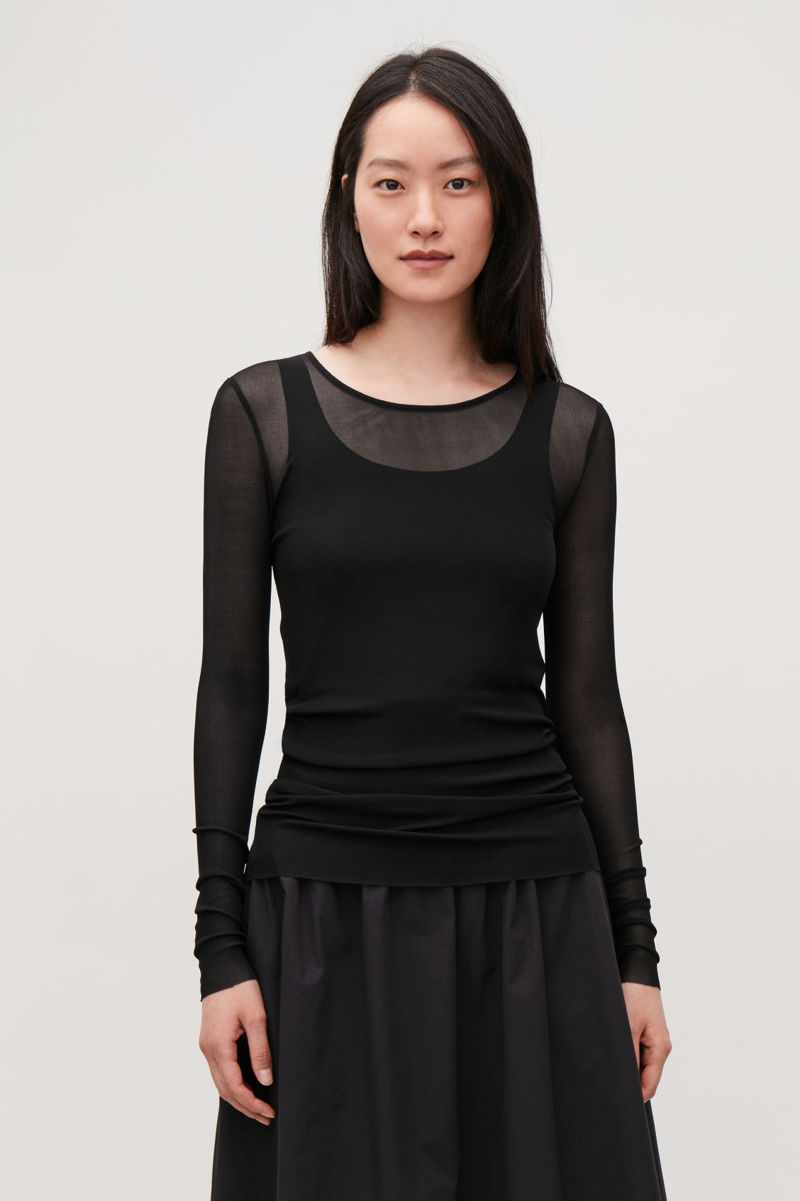 Model side image of Cos silk jersey top in black
