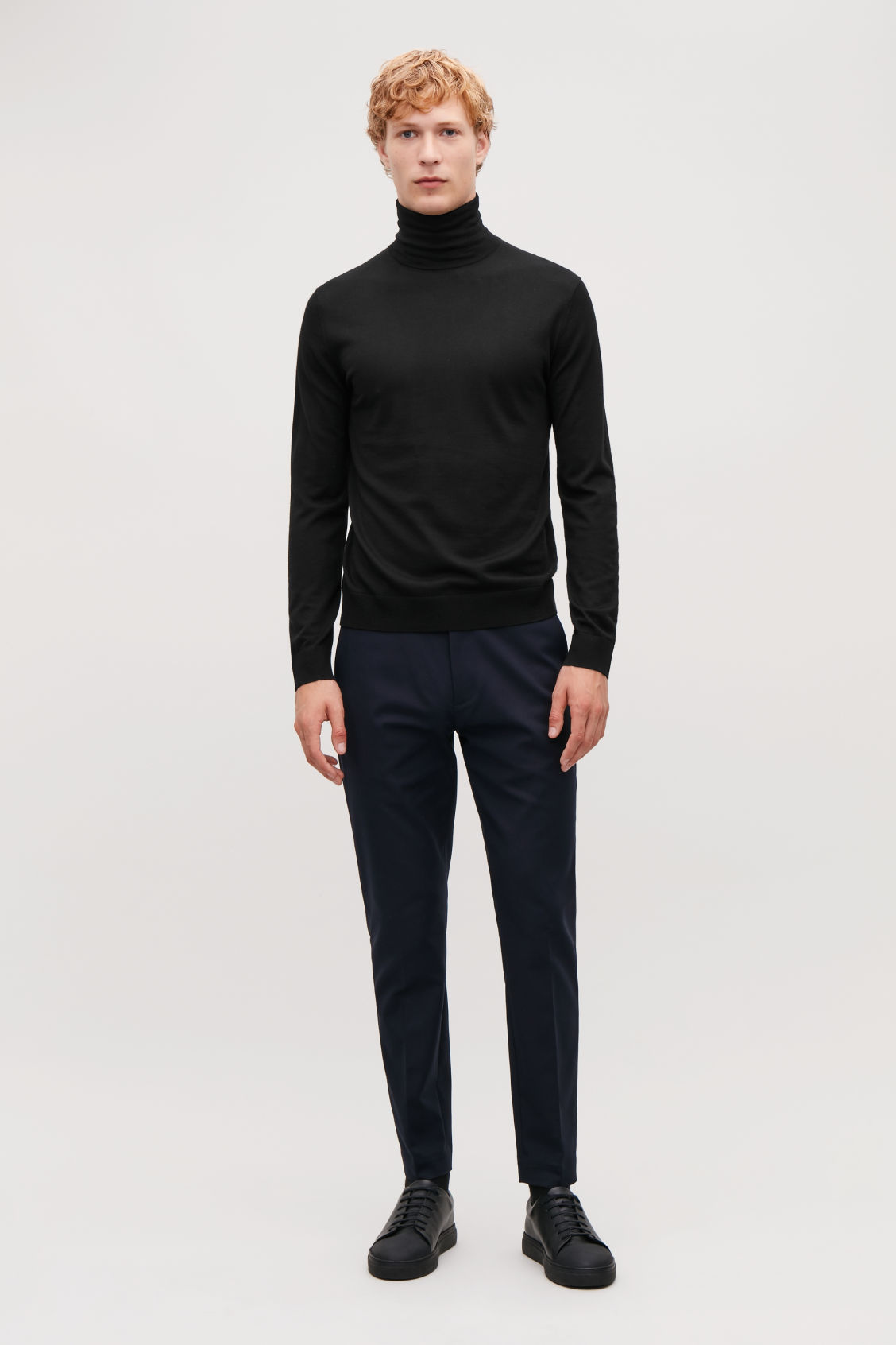Model front image of Cos merino roll-neck jumper in black