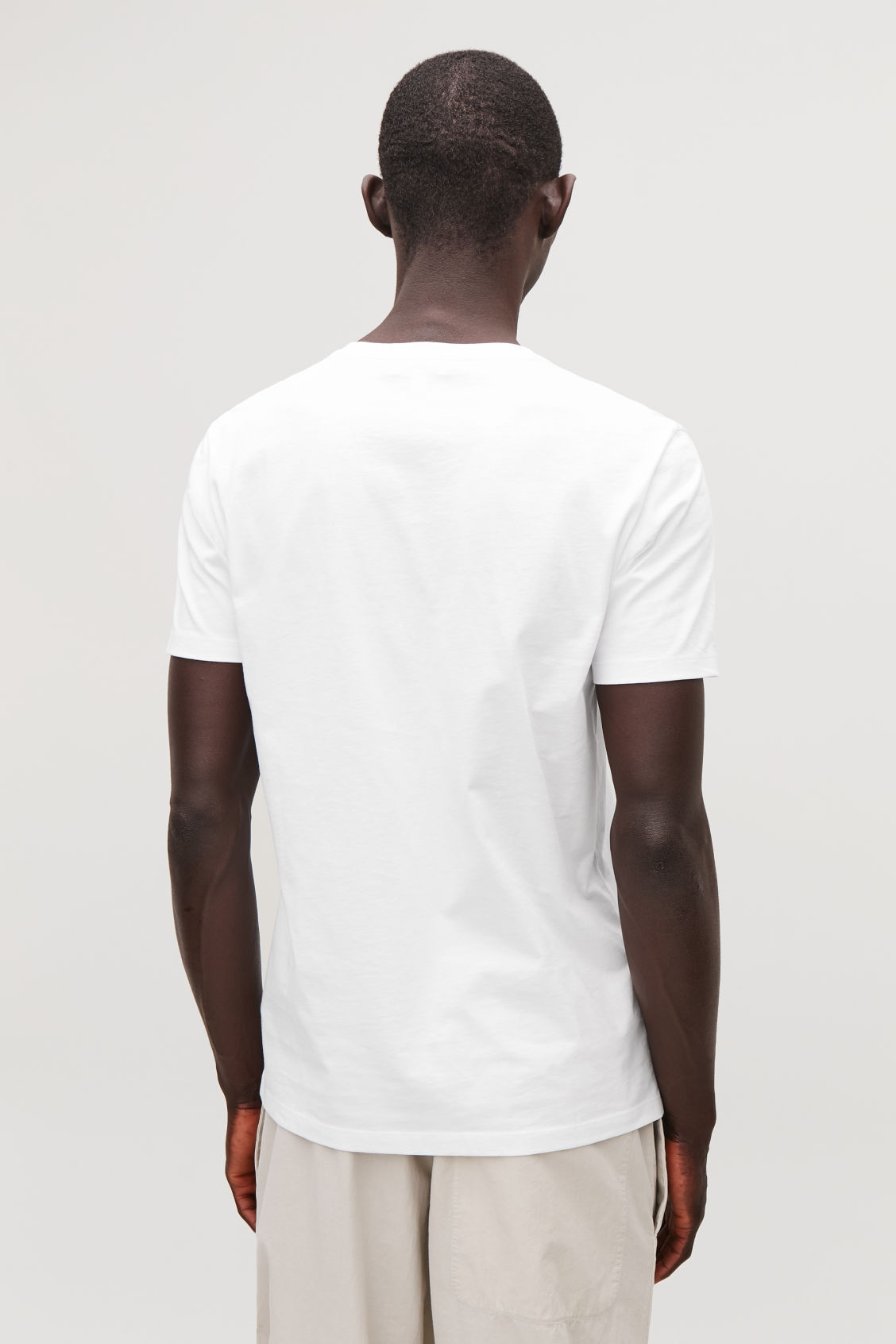 Model side image of Cos round-neck t-shirt in white