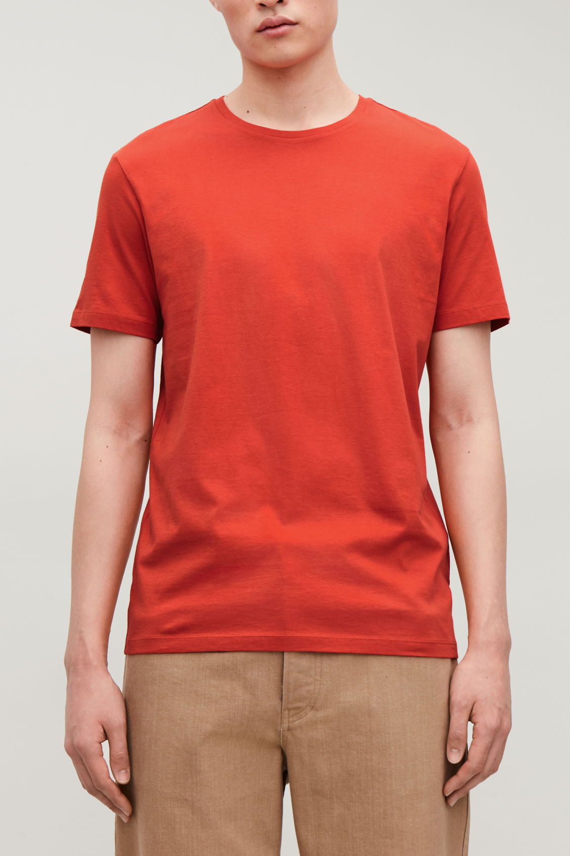 Model side image of Cos round-neck t-shirt in orange