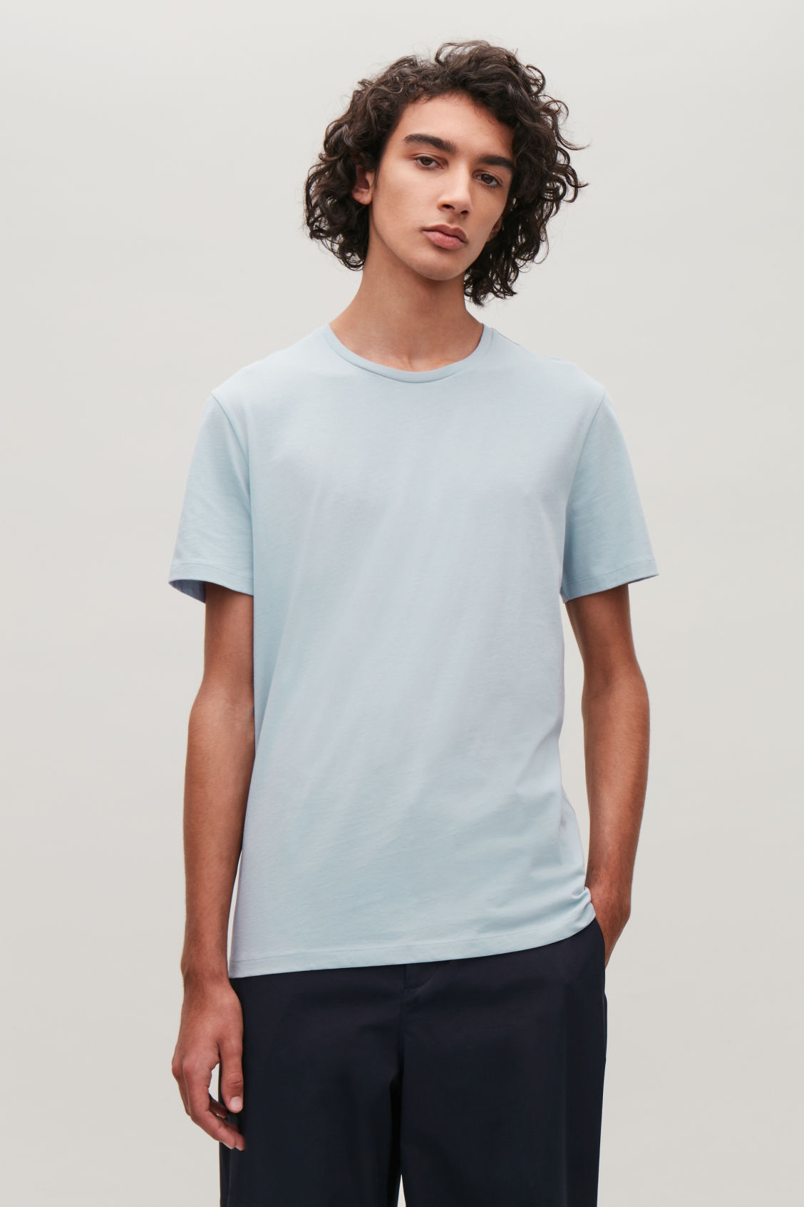 Model side image of Cos round-neck t-shirt in blue