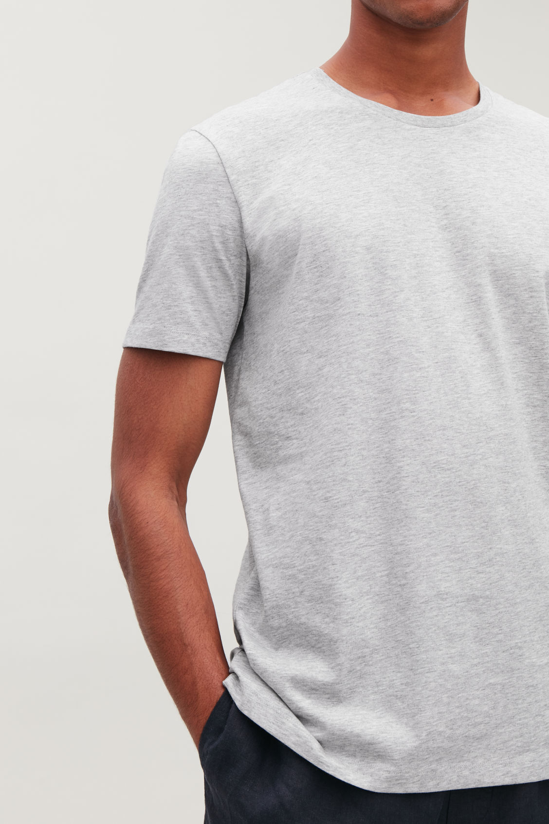 Model side image of Cos round-neck t-shirt in grey