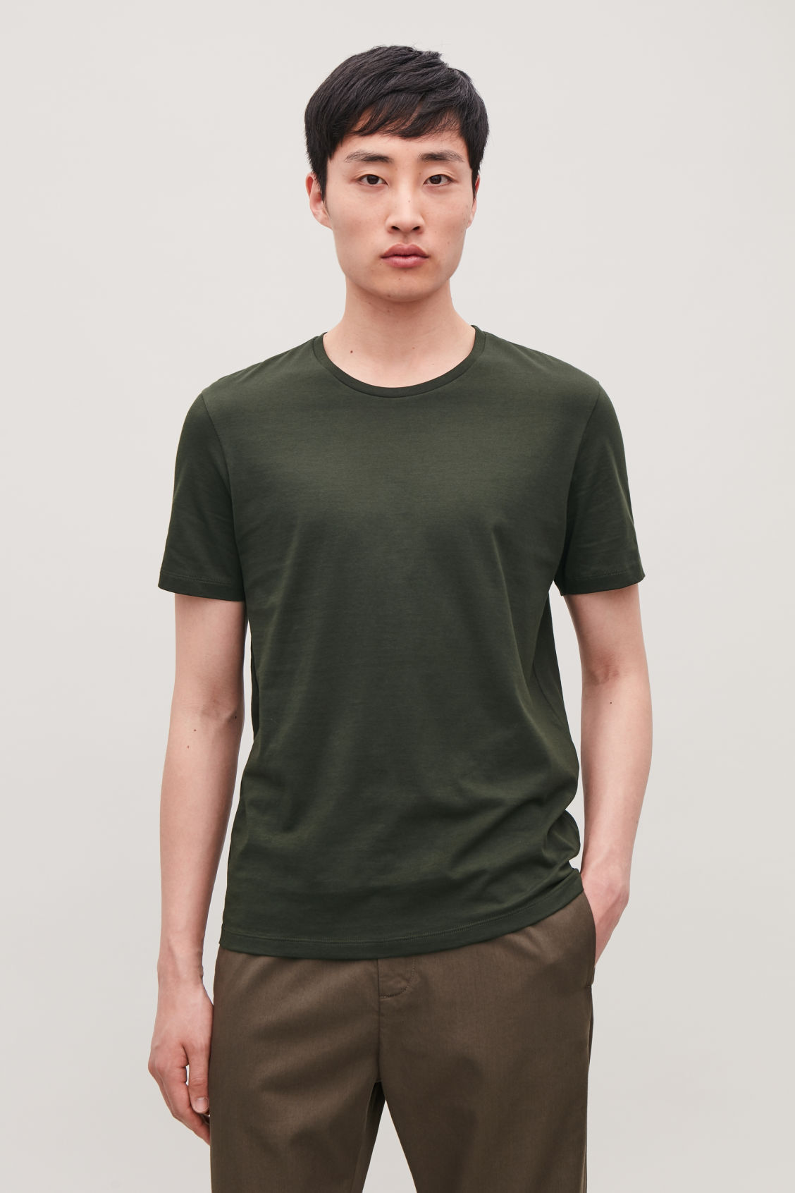 Model side image of Cos round-neck t-shirt in green