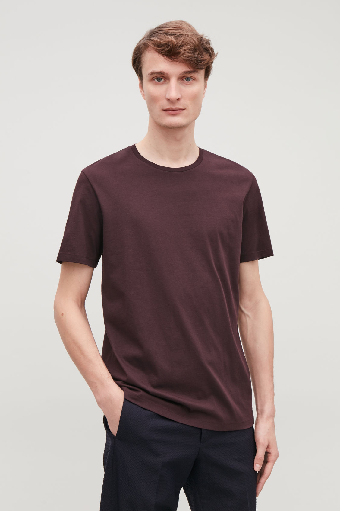 Model side image of Cos round-neck t-shirt in burgundy