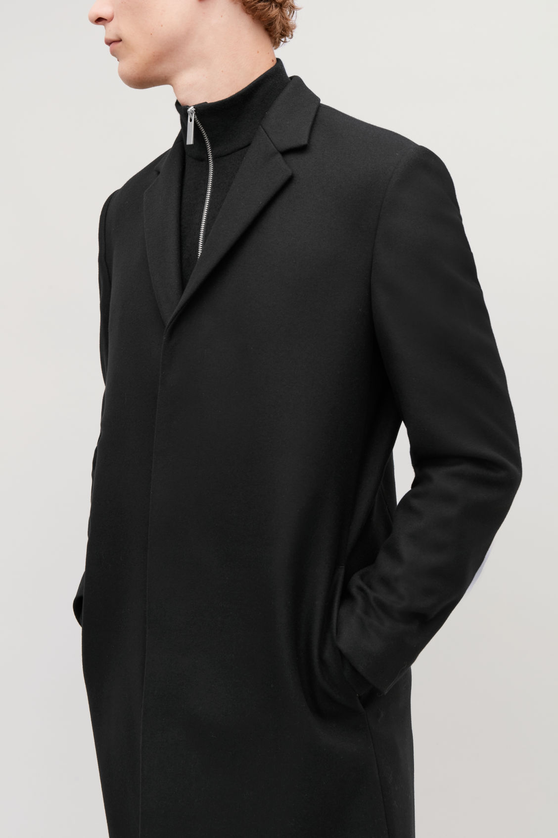Model side image of Cos tailored coat in black