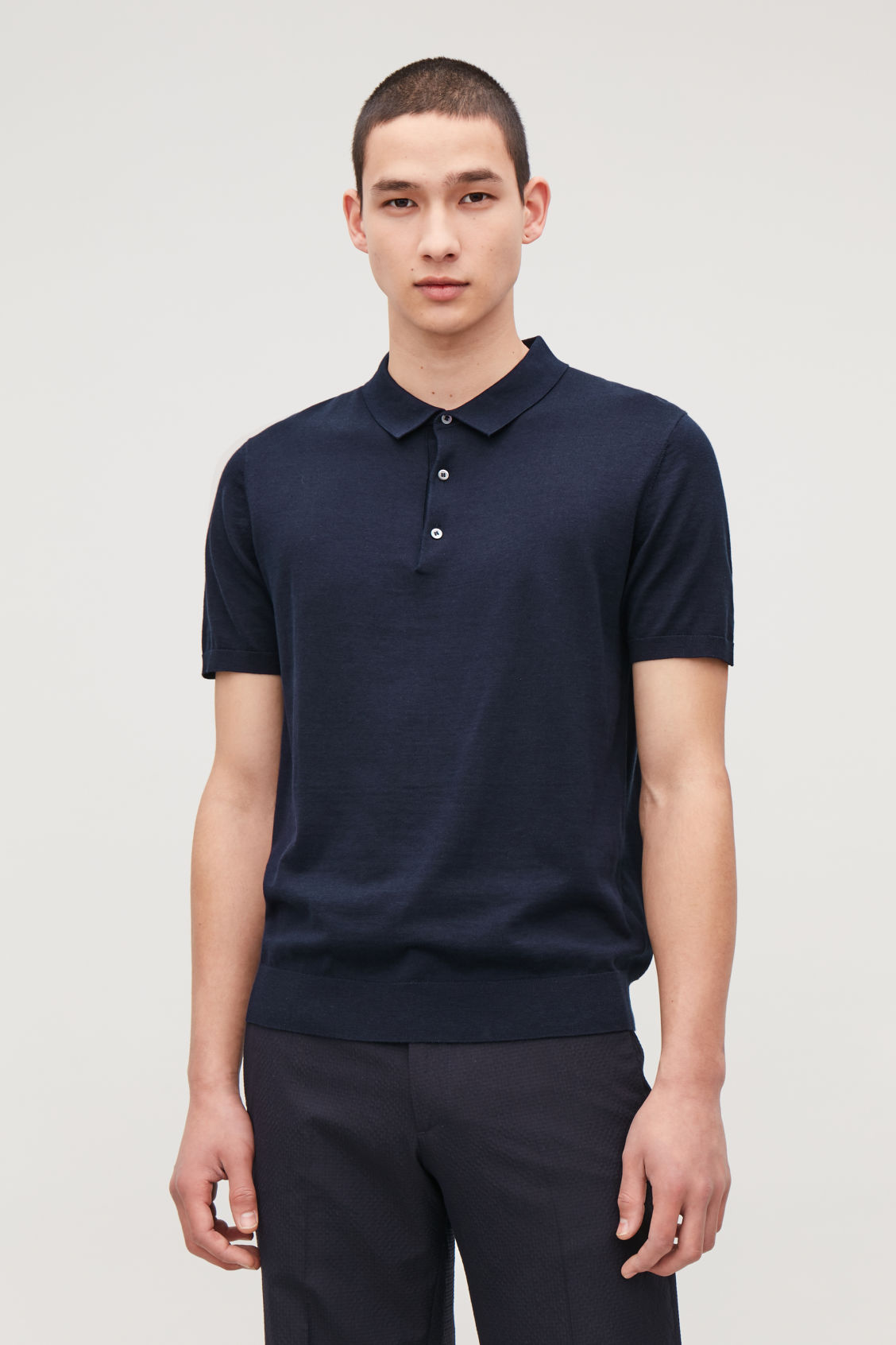 Model side image of Cos silk-cotton polo shirt in blue