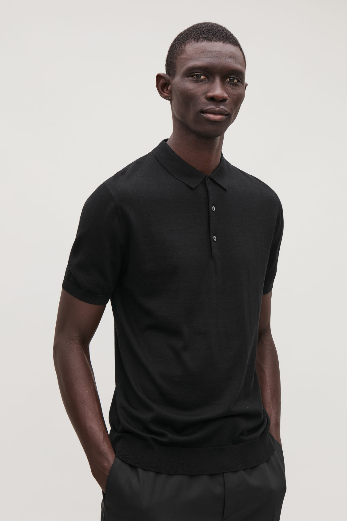Model side image of Cos silk-cotton polo shirt in black