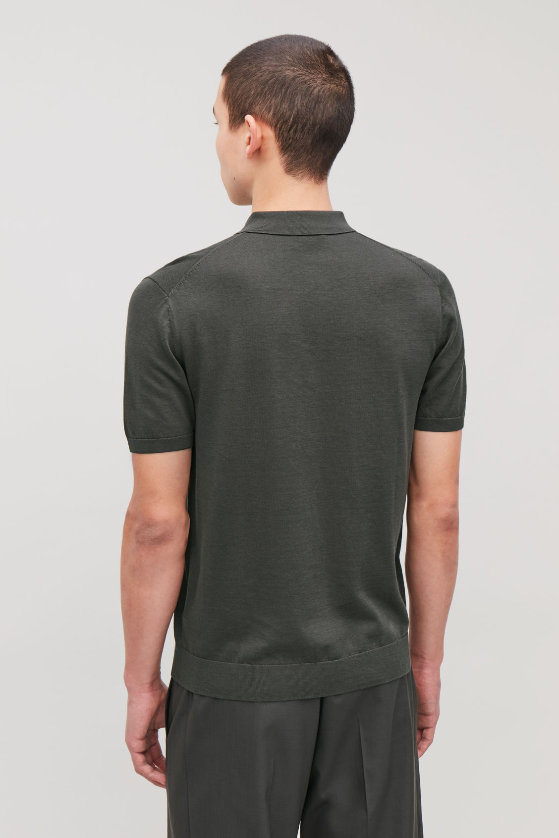 Model side image of Cos silk-cotton polo shirt in green