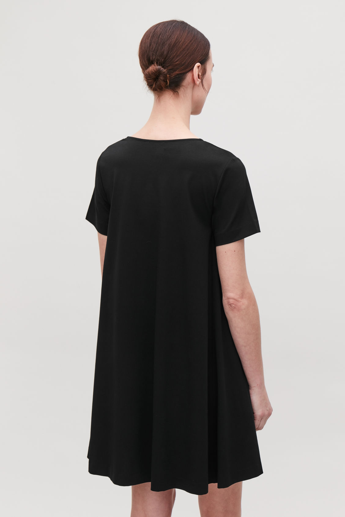 Model side image of Cos a-line jersey dress in black