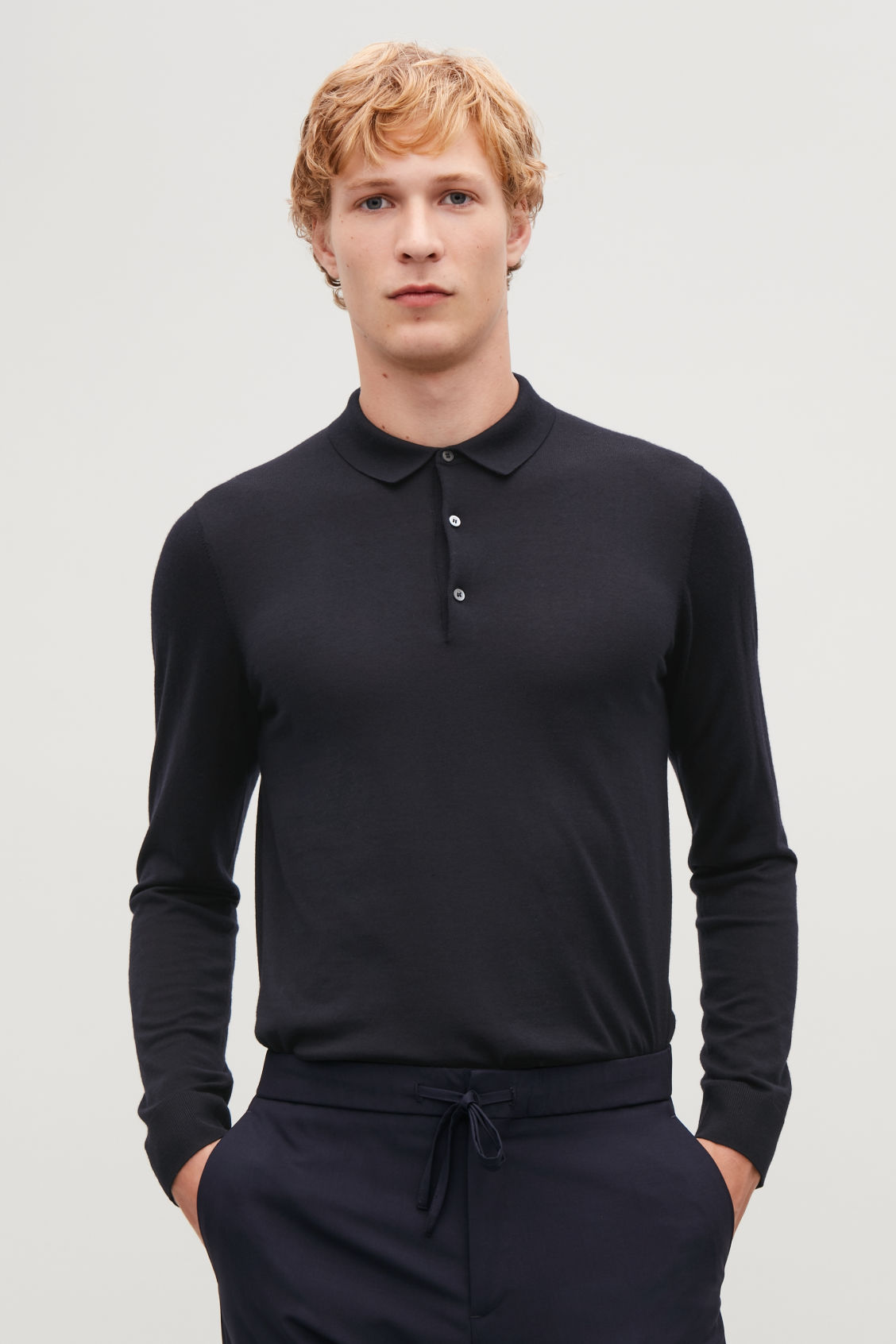 Model side image of Cos merino polo-neck jumper  in blue