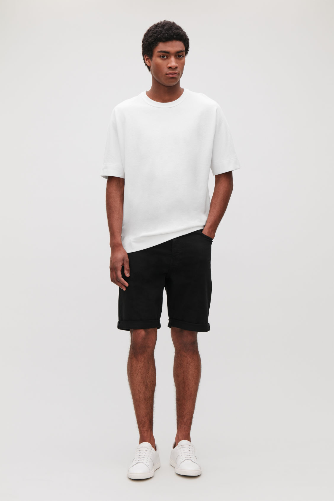 Model front image of Cos denim shorts in black