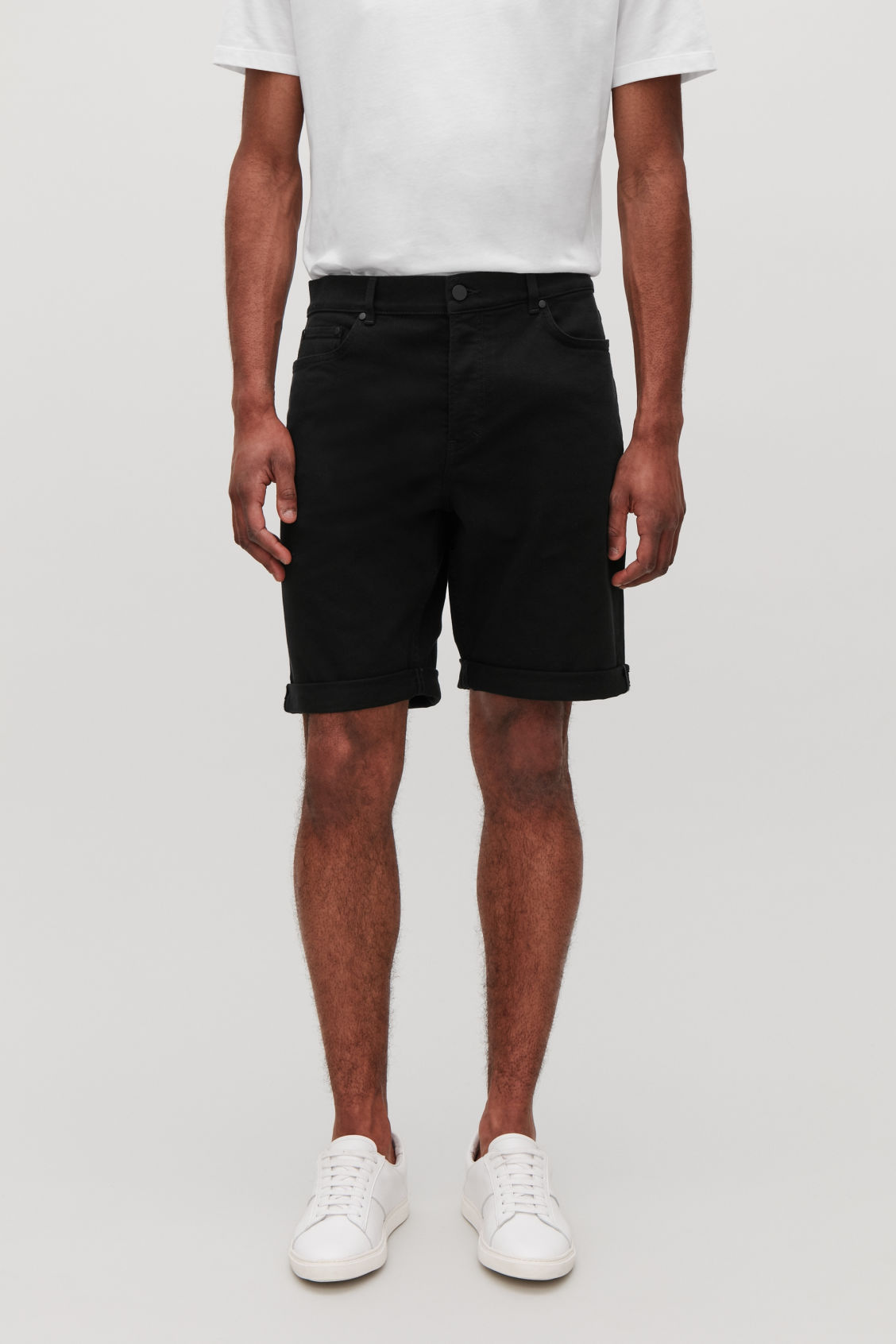 Model side image of Cos denim shorts in black