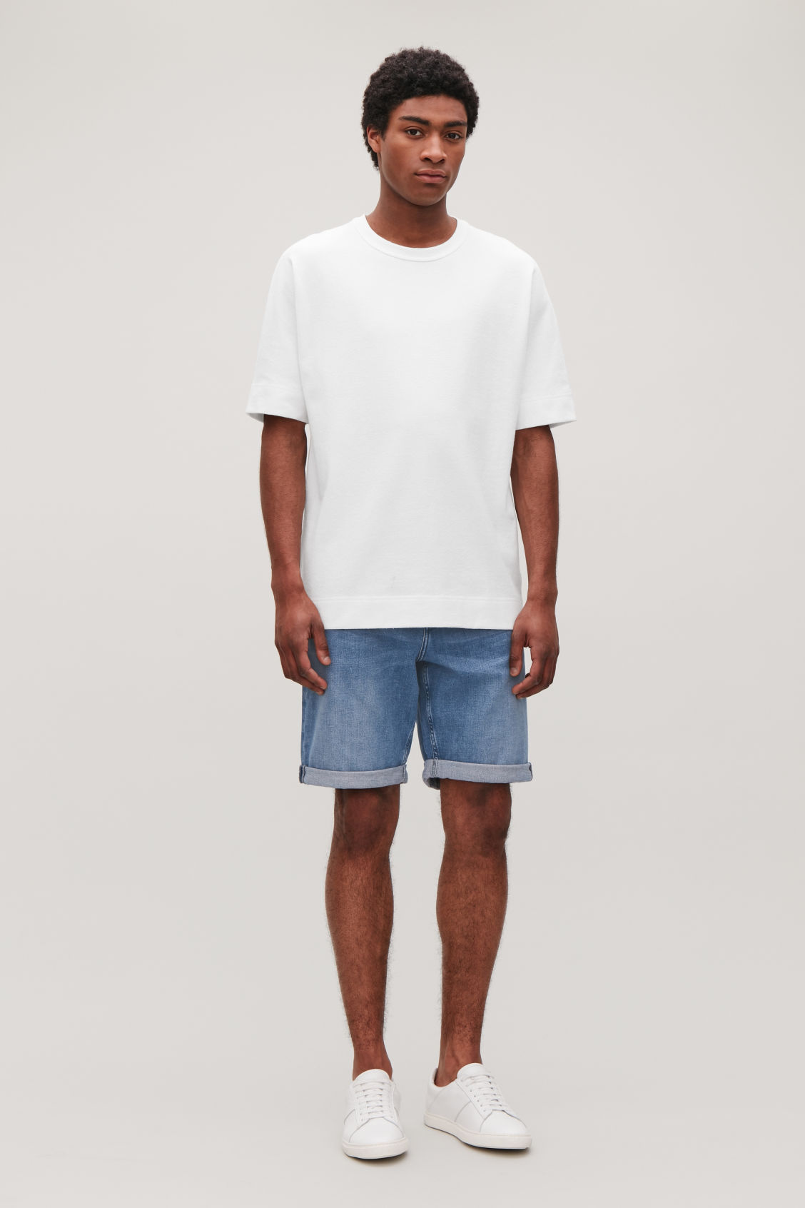 Model front image of Cos denim shorts in blue