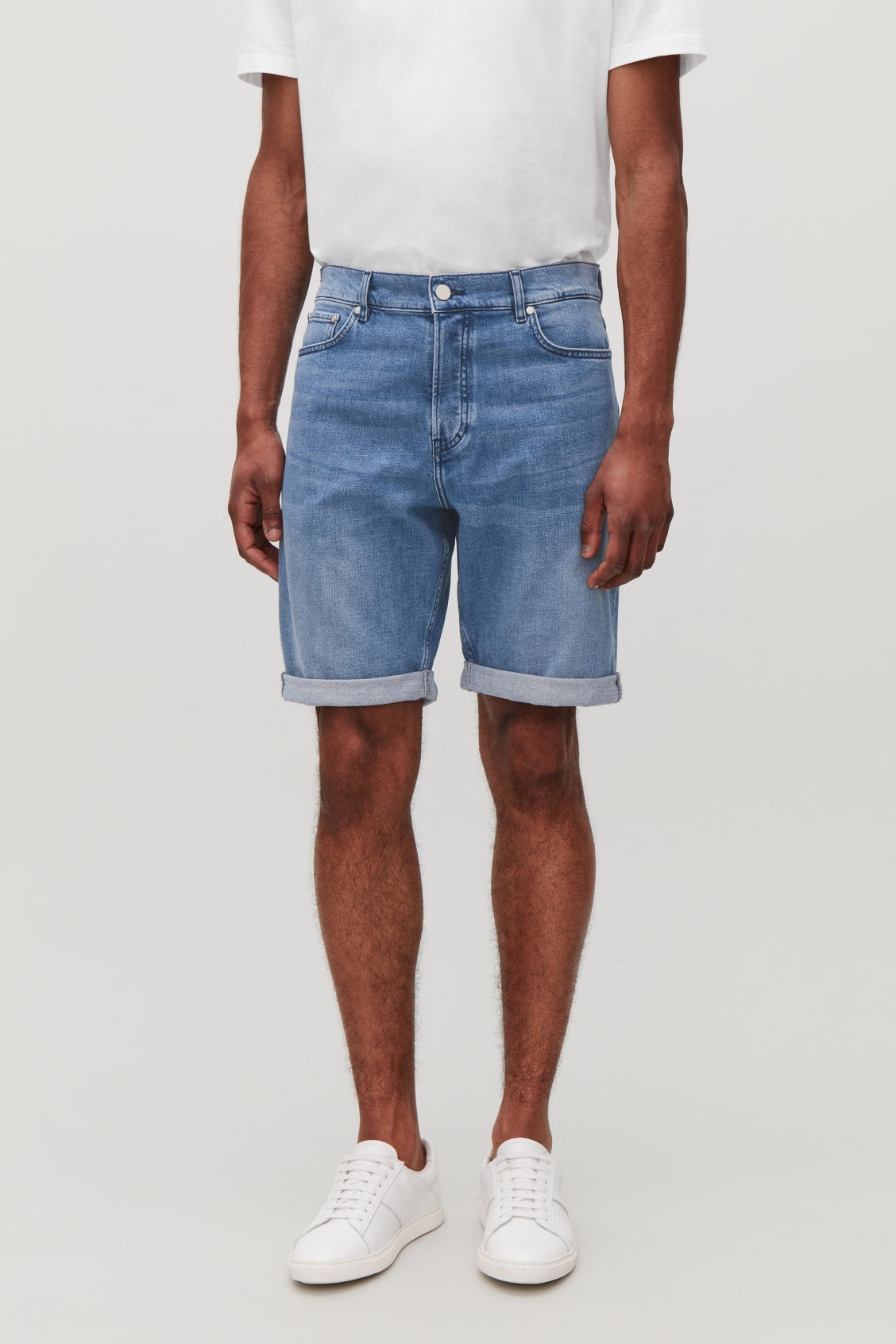 Model side image of Cos denim shorts in blue