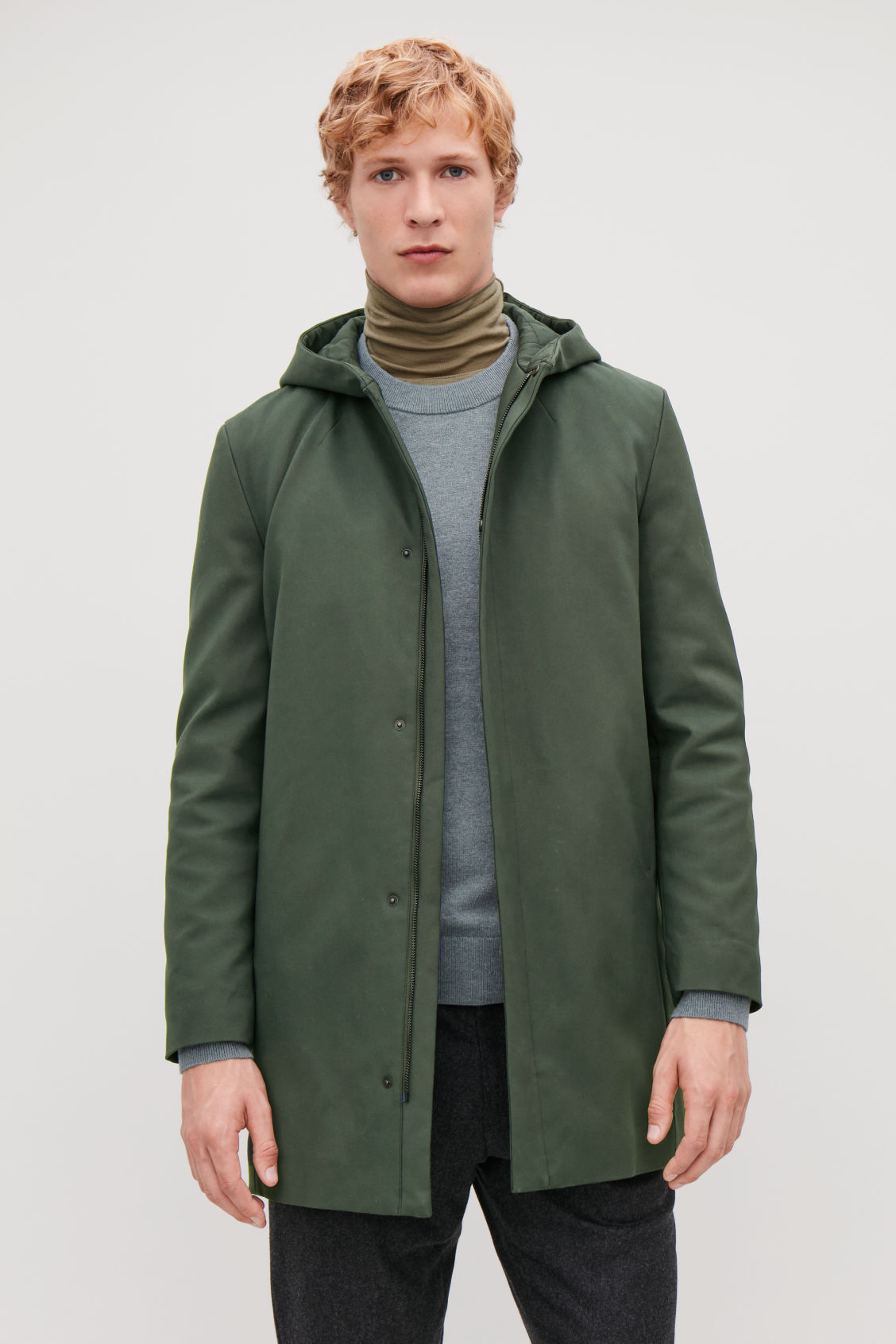 Model side image of Cos padded cotton parka in green