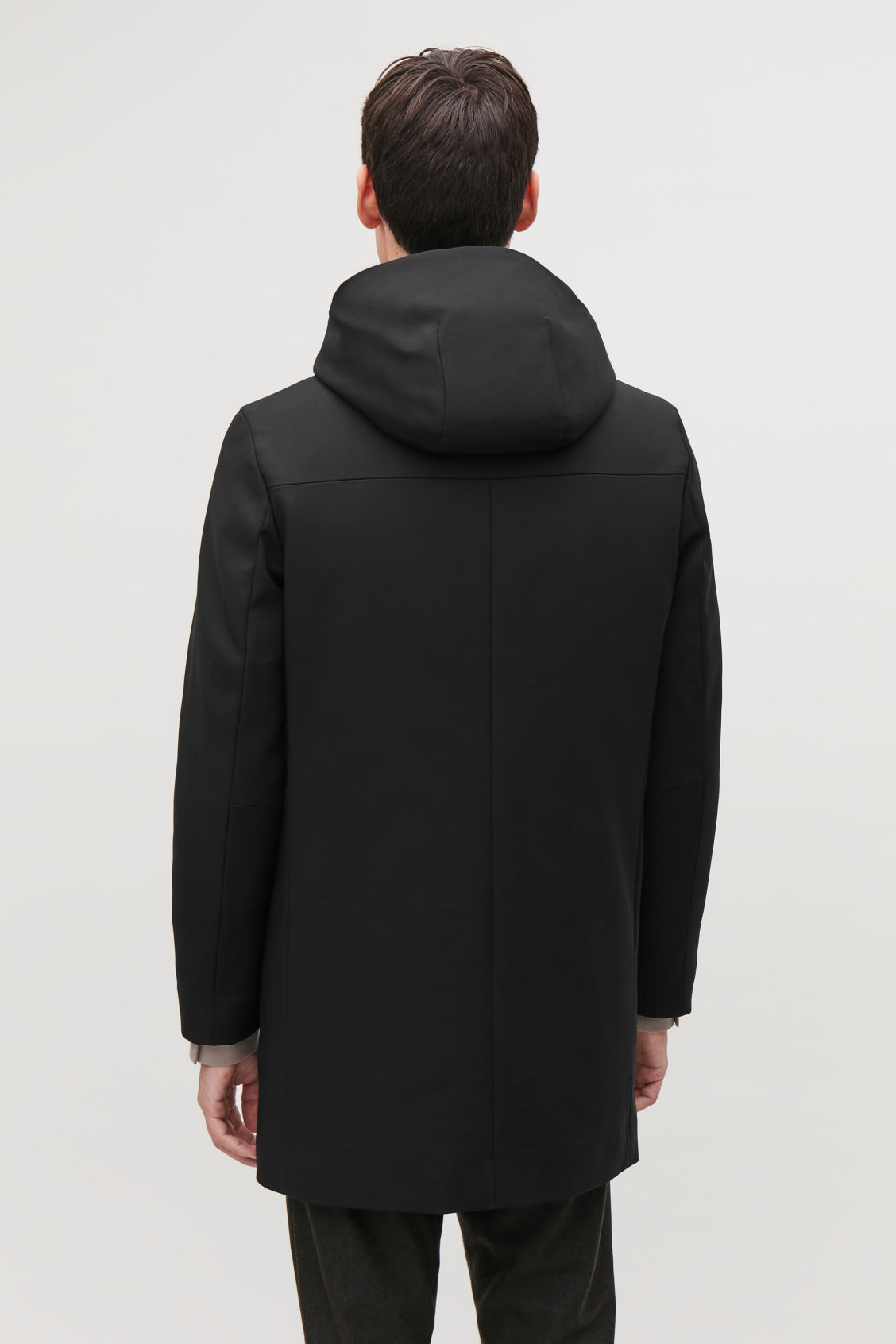 Model side image of Cos padded cotton parka in black