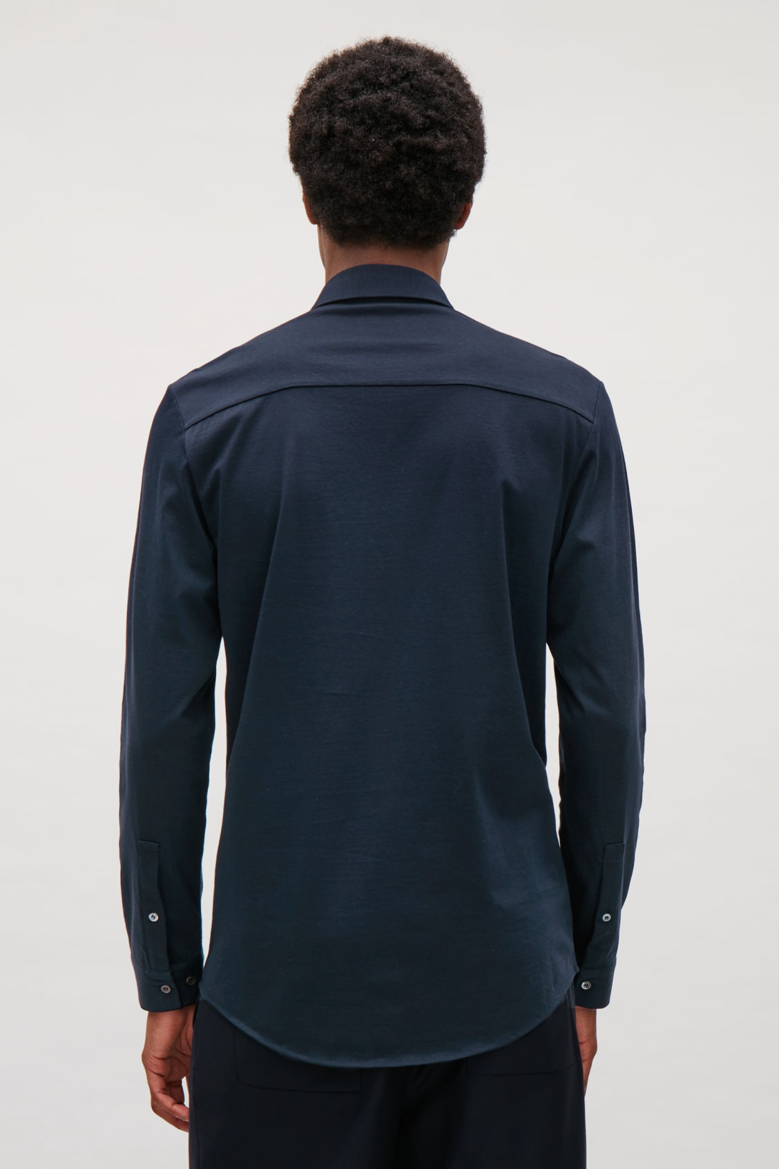 Model side image of Cos jersey shirt in blue