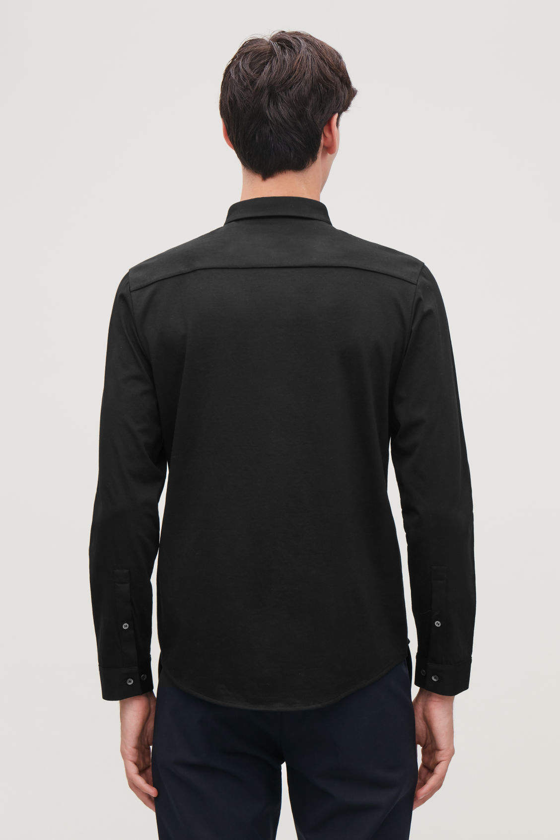 Model side image of Cos jersey shirt in black