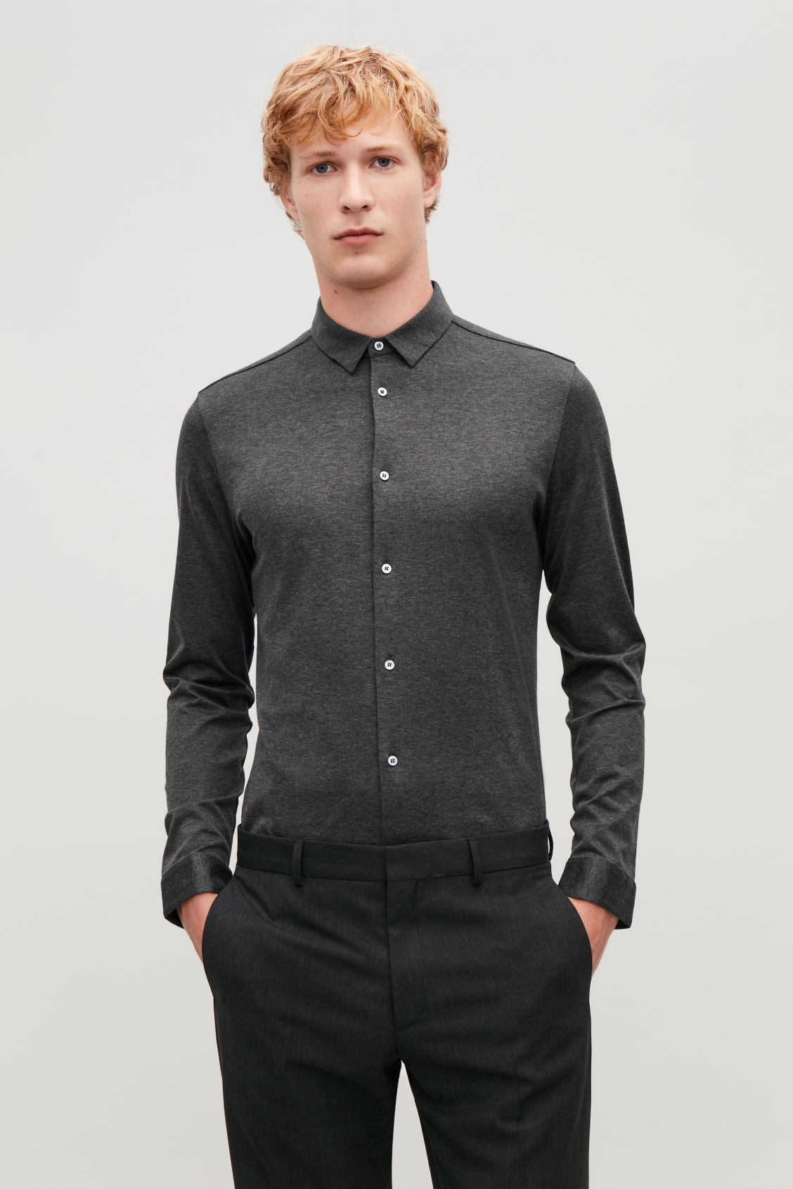 Model side image of Cos jersey shirt in grey