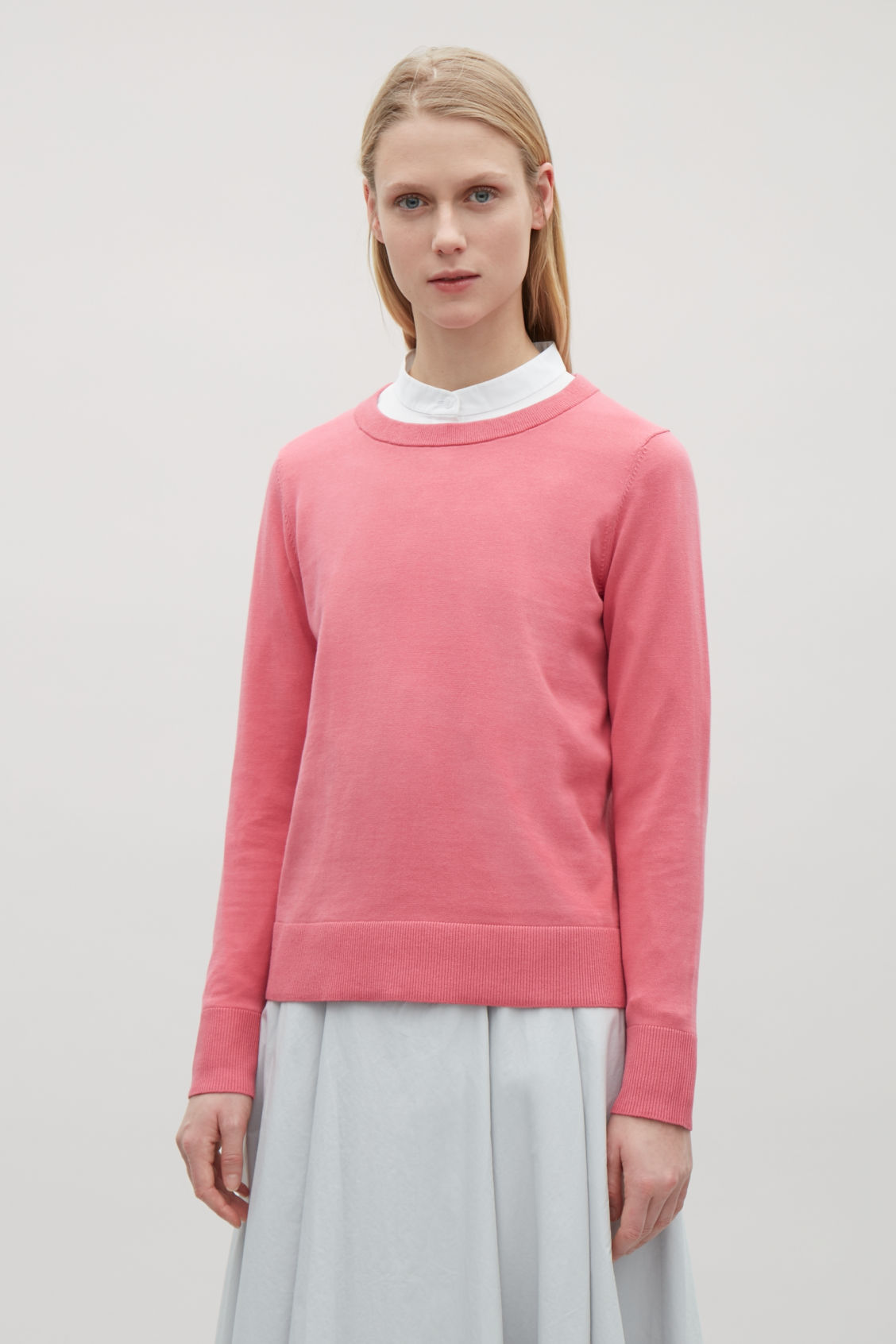 Model side image of Cos cotton-knit jumper in pink