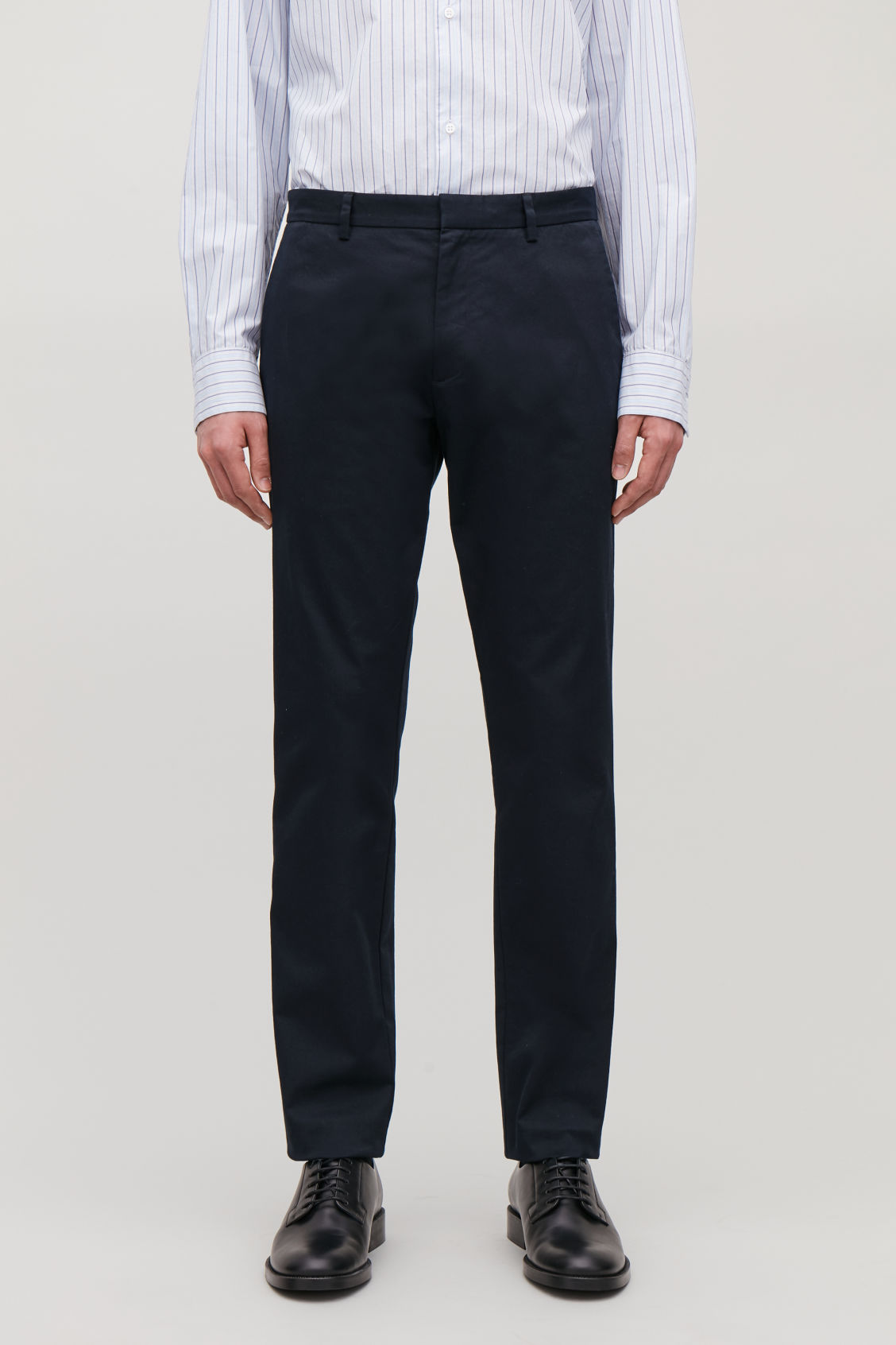 Model side image of Cos stretch-cotton chinos in blue