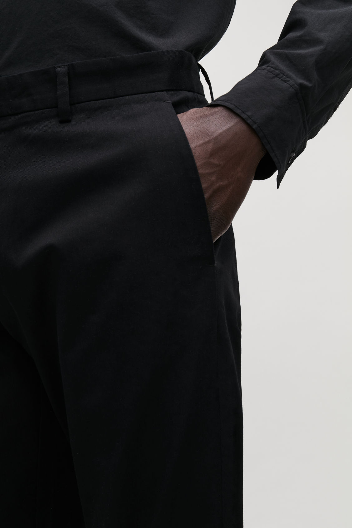 Model side image of Cos stretch-cotton chinos in black