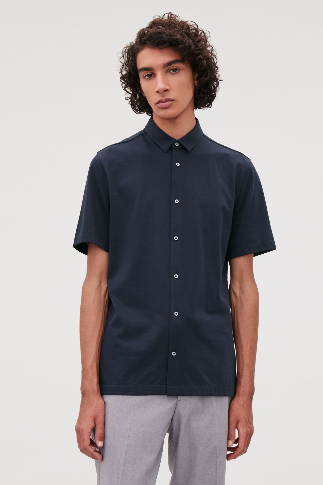 Model side image of Cos short-sleeved jersey shirt in blue