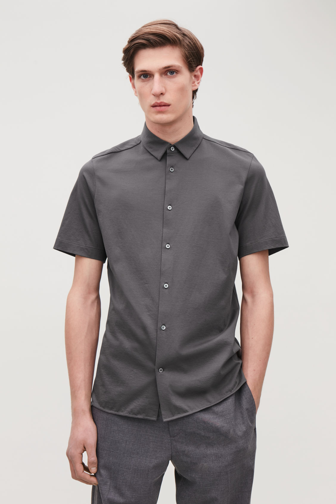 Model side image of Cos short-sleeved jersey shirt in grey