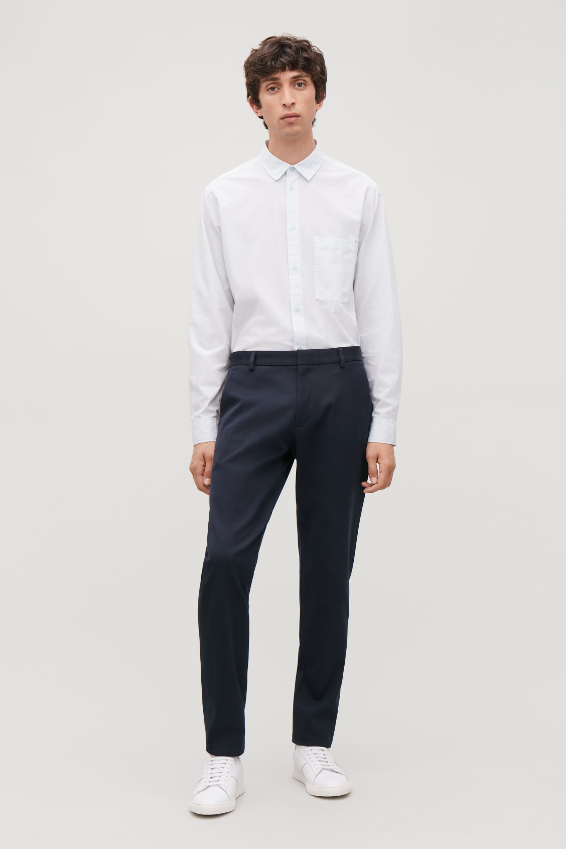 Model front image of Cos slim-fit chinos in blue