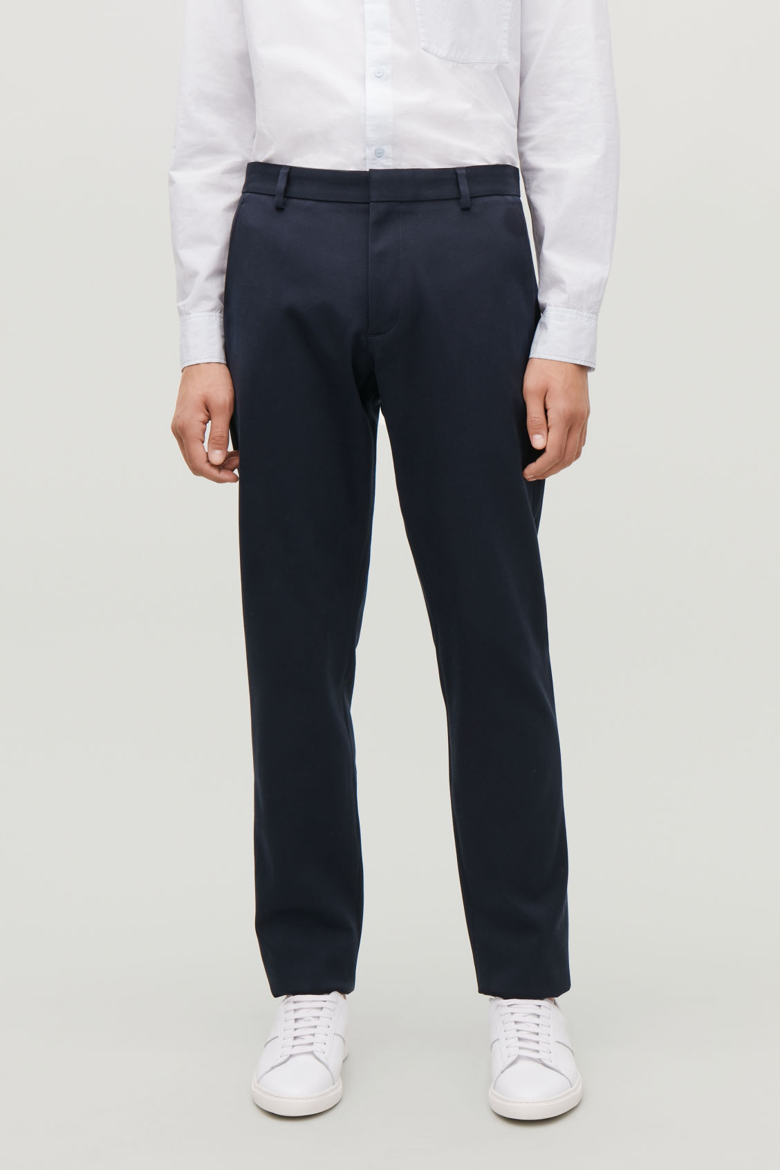 Model side image of Cos slim-fit chinos in blue