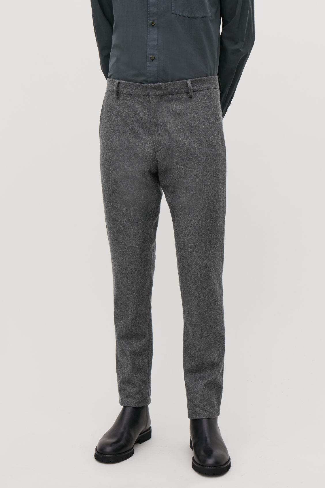 Model side image of Cos slim wool trousers in grey
