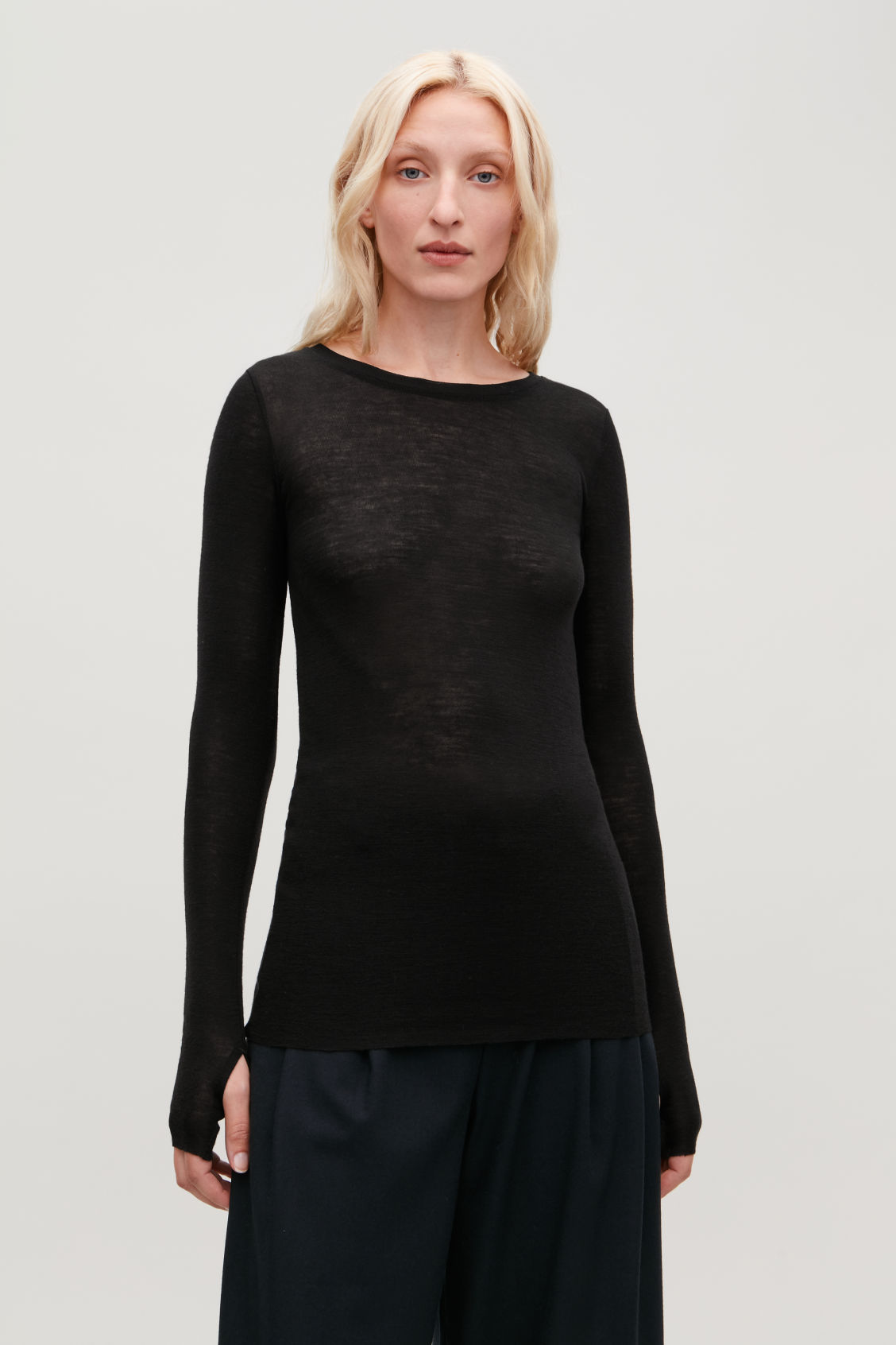 Model side image of Cos wide-neck wool top in black