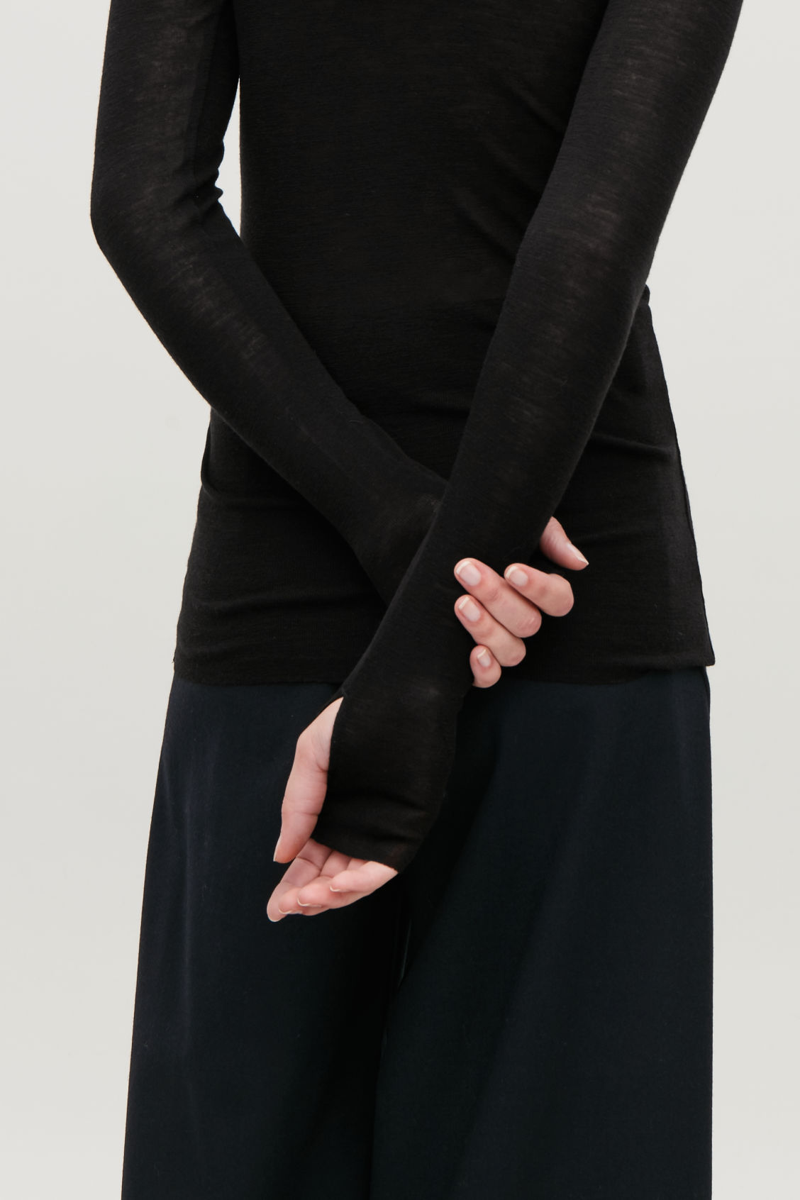 Model side image of Cos sheer wool long-sleeved top in black