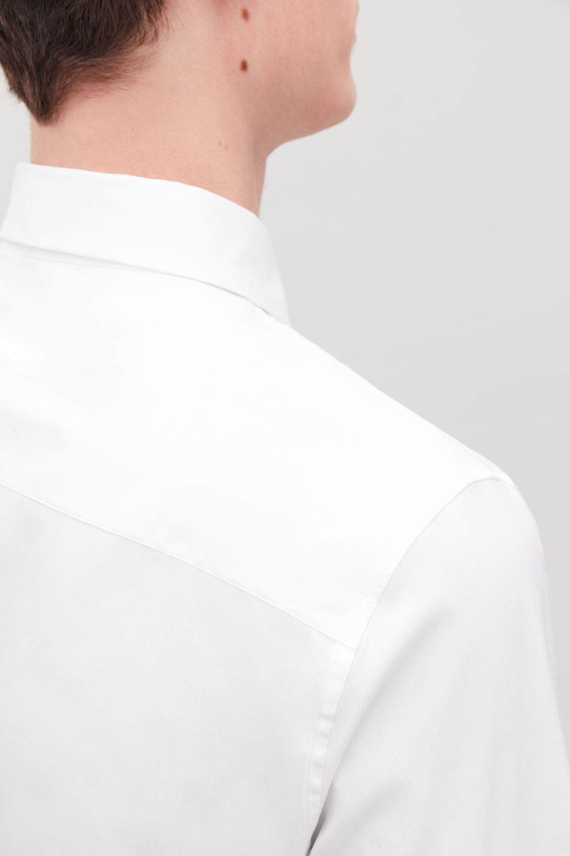 Model side image of Cos slim-fit cotton shirt in white