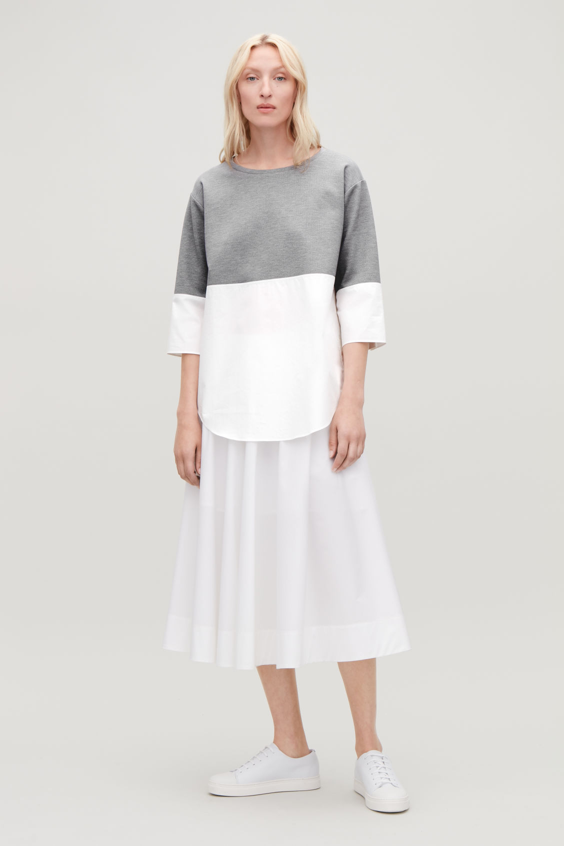 Model front image of Cos jumper with shirt hem in grey