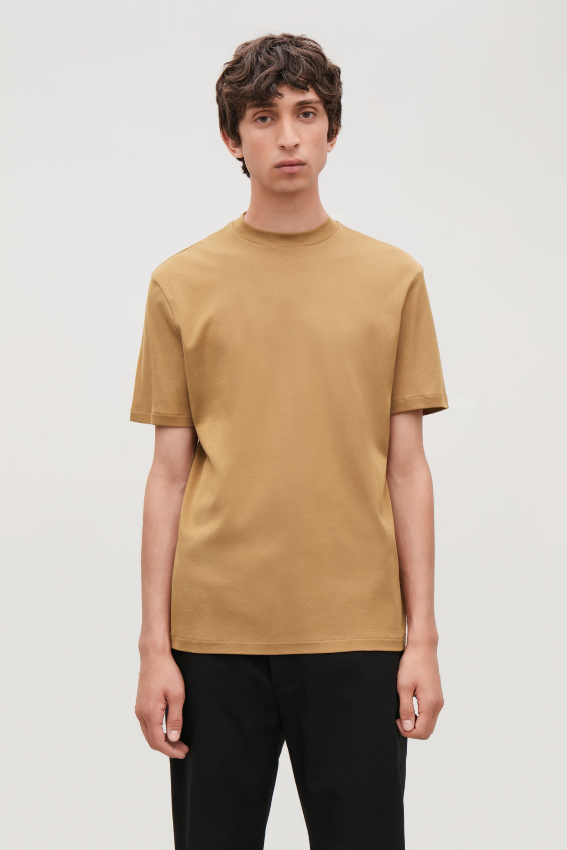 Model side image of Cos t-shirt with raised neck in beige