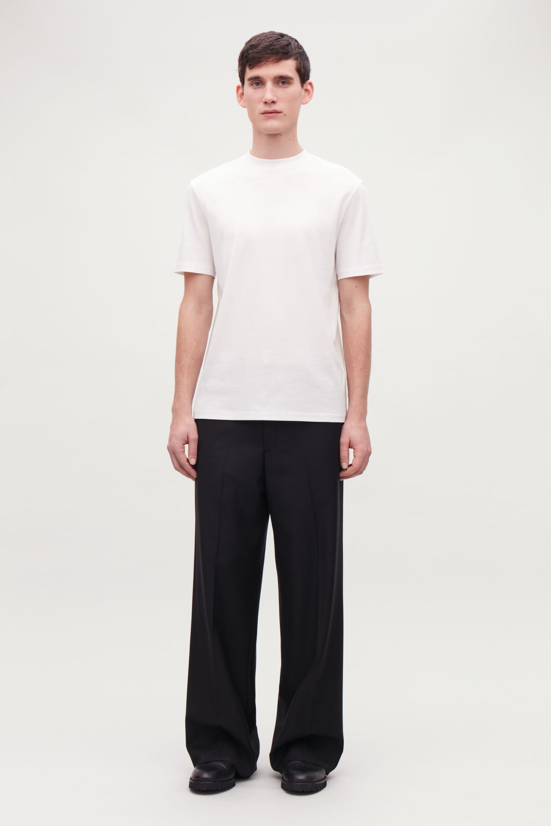 Model front image of Cos t-shirt with mock neck in white