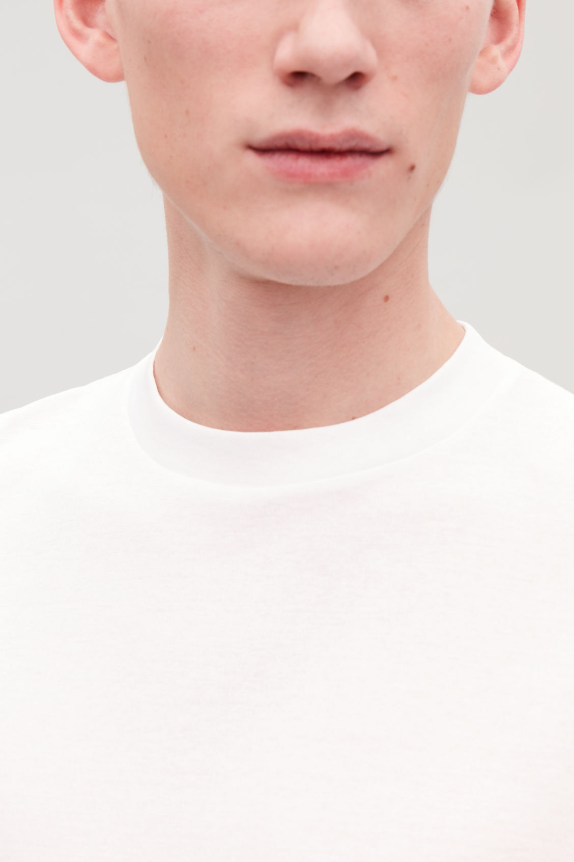 Model side image of Cos t-shirt with mock neck in white