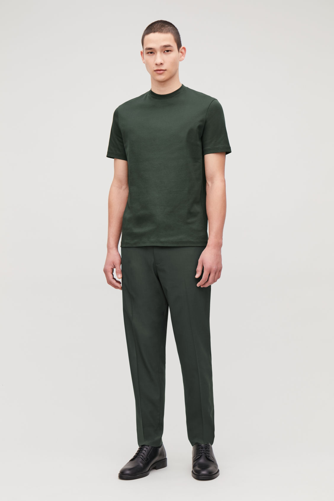 Model front image of Cos t-shirt with mock neck in green