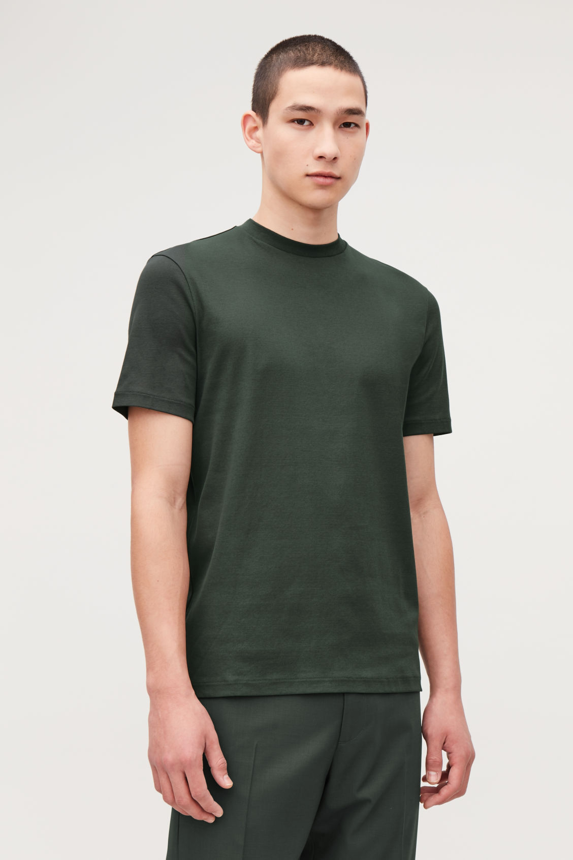 Model side image of Cos t-shirt with mock neck in green