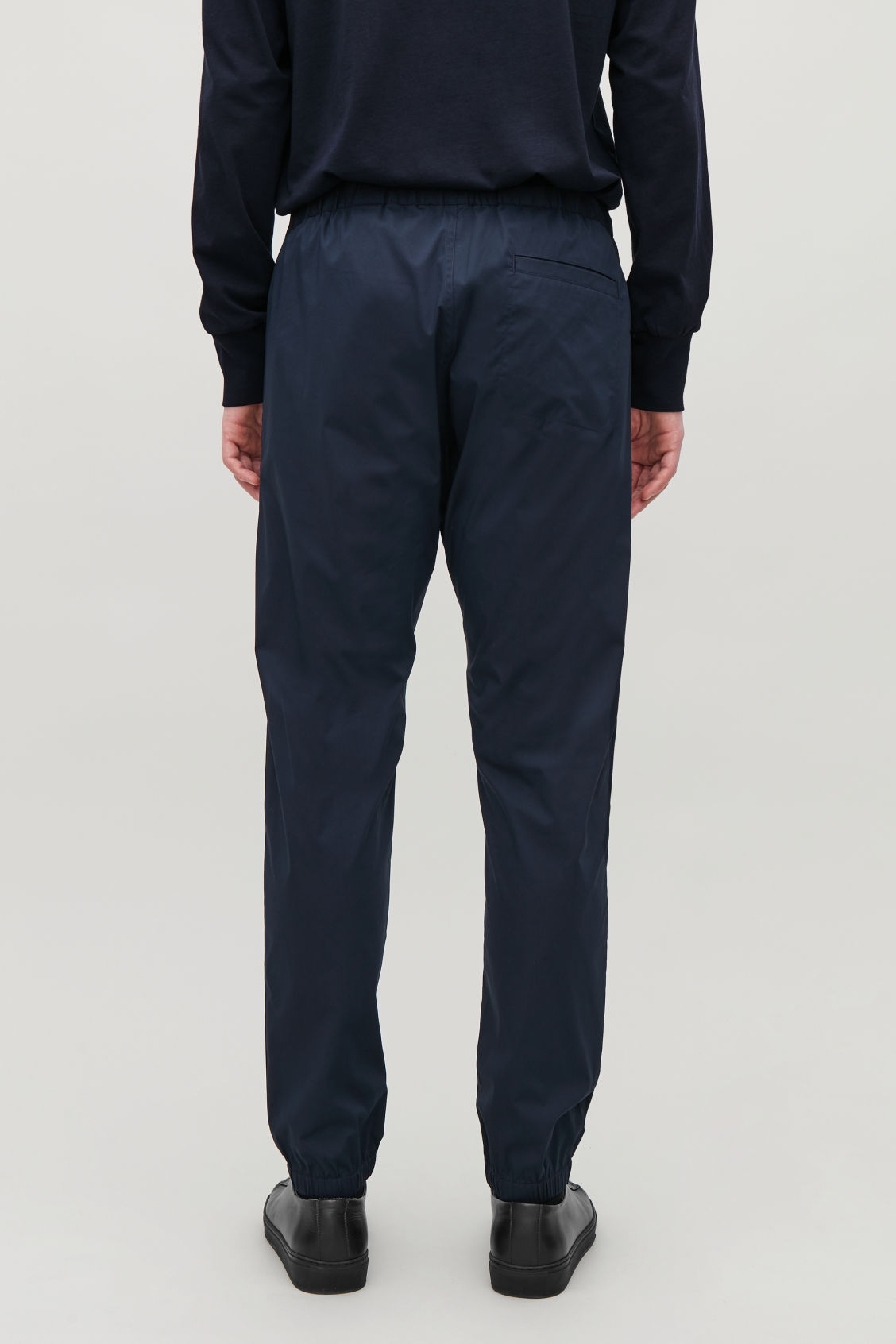 Model side image of Cos elastic-waist cotton trousers in blue