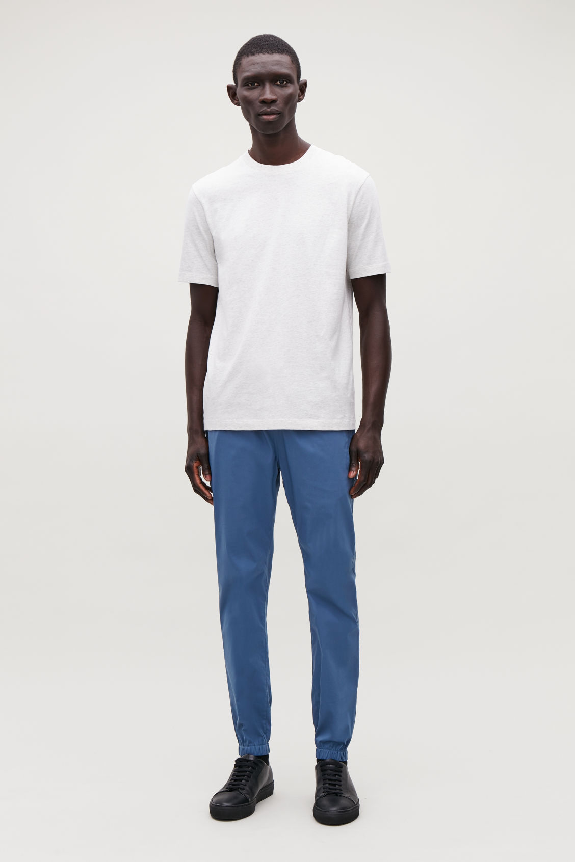 Model front image of Cos elastic-waist cotton trousers in blue