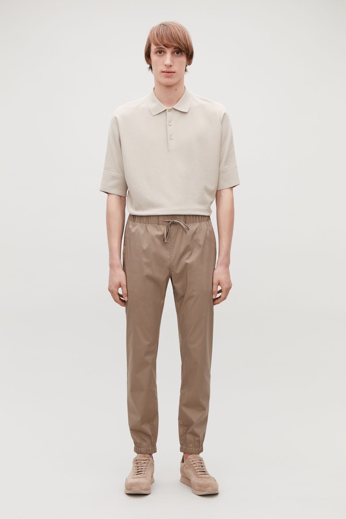 Model front image of Cos elastic-waist cotton trousers in beige