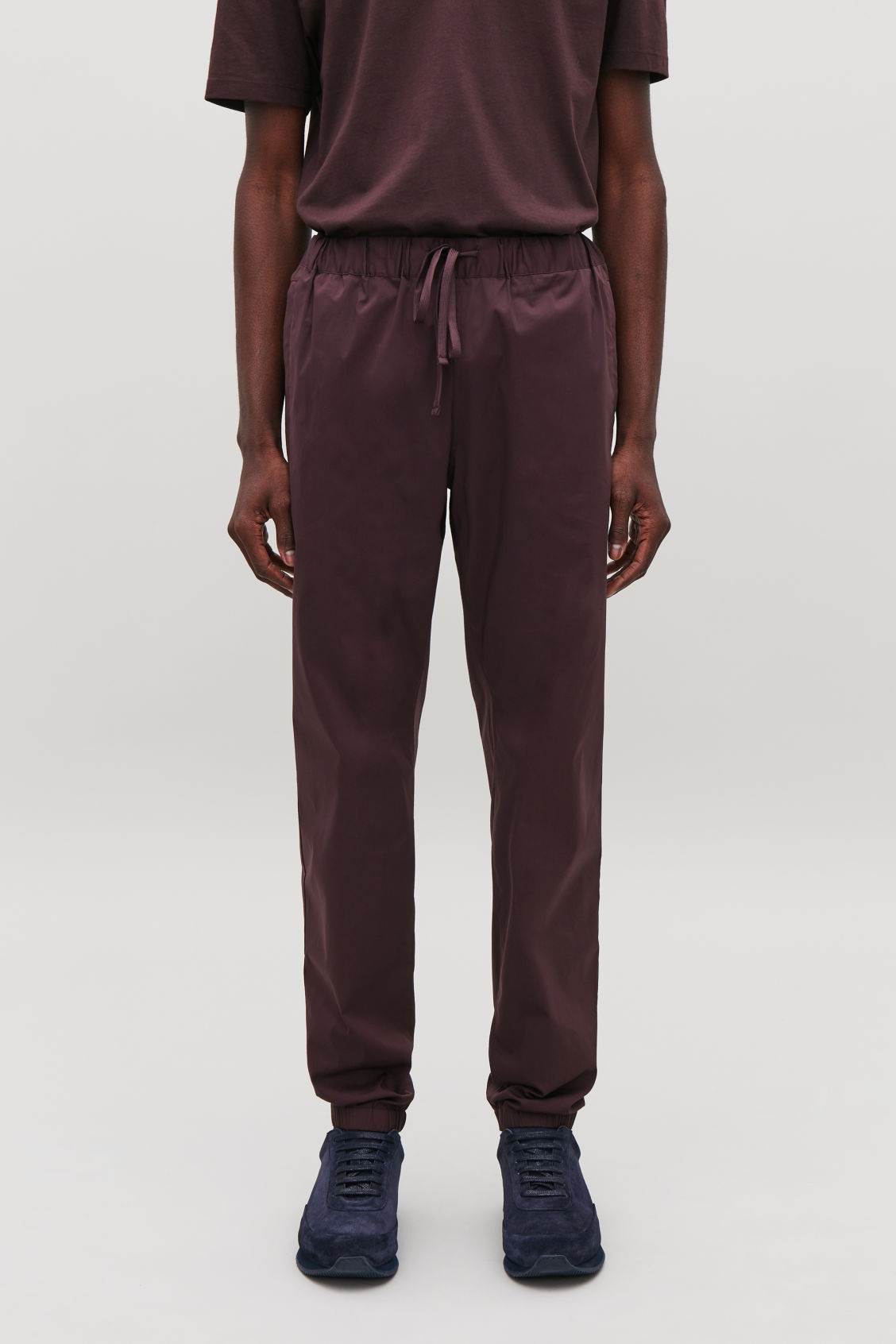 Model side image of Cos elastic-waist cotton trousers in red