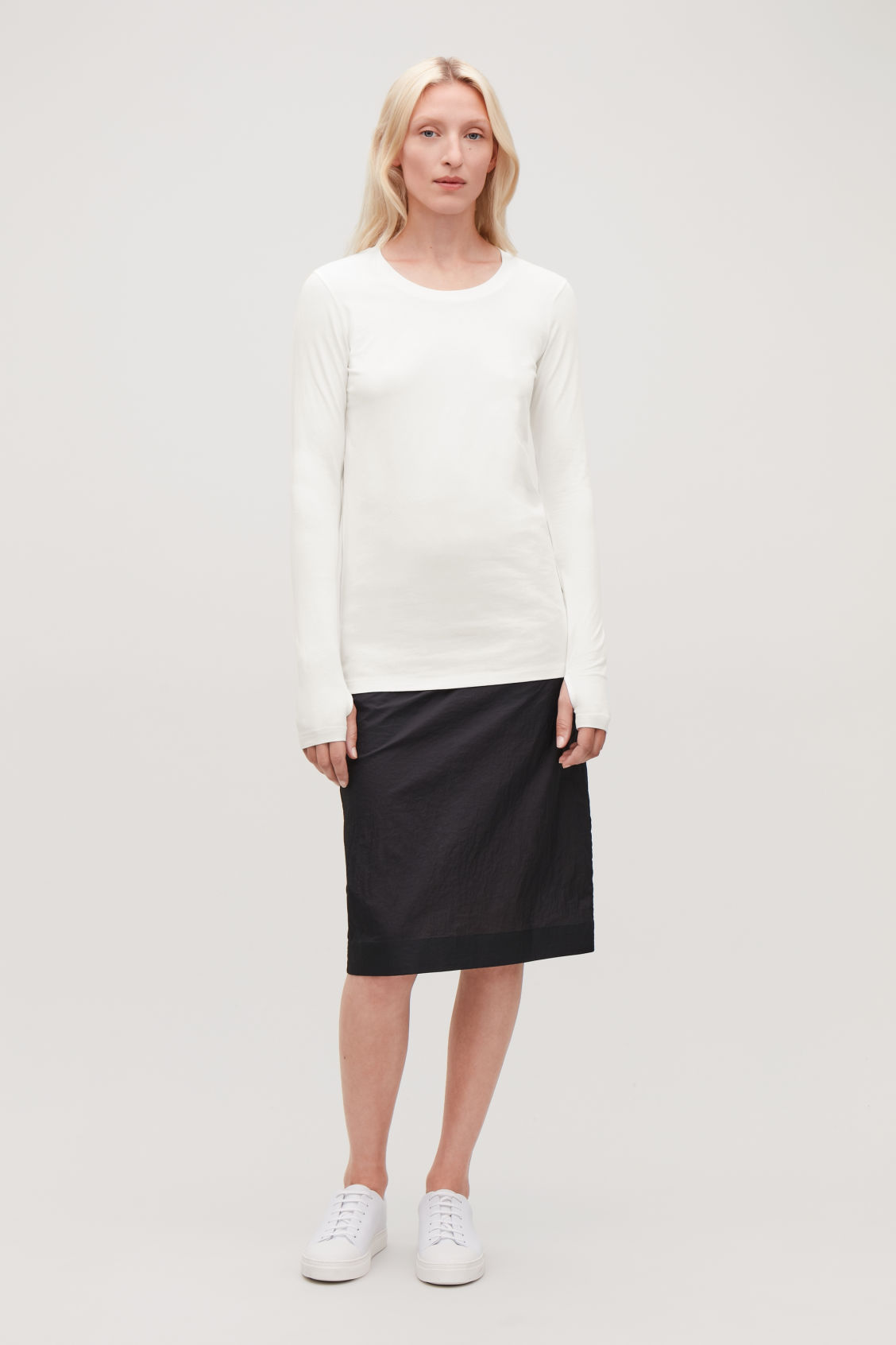 Model front image of Cos slim-fit top with thumbholes in white