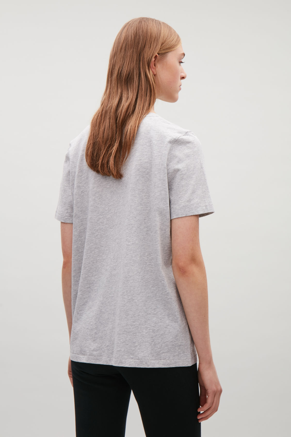 Model side image of Cos v-neck cotton t-shirt in grey
