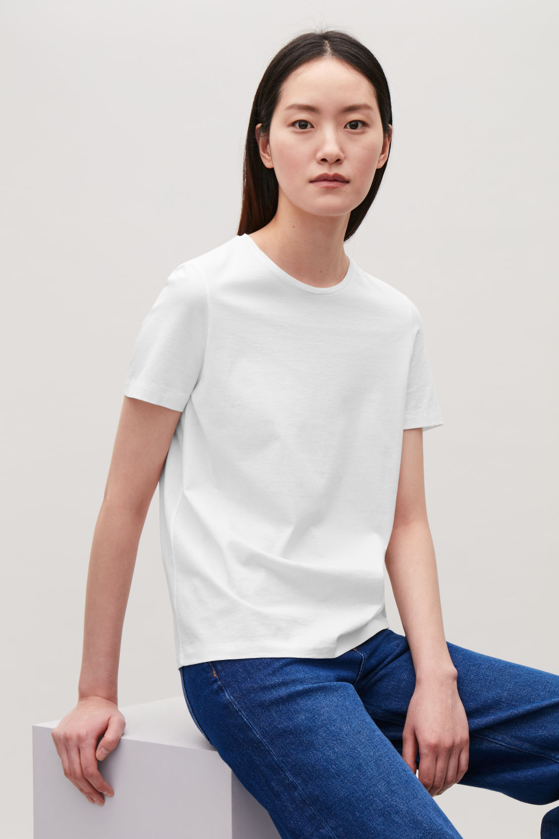 Model side image of Cos classic t-shirt in white